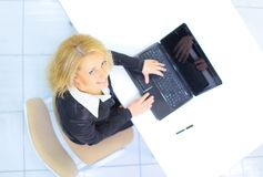 businesswoman working on the laptop in the office Royalty Free Stock Image