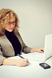 Businesswoman is working with Laptop. In office stock photography