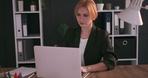 Businesswoman working on laptop at office. Desk stock video footage