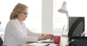 Businesswoman working on laptop at office stock video footage