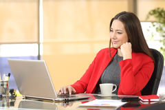 Businesswoman working with a laptop at office Stock Image