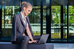 Businesswoman working with laptop outdoor Royalty Free Stock Photography
