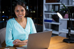 Businesswoman working on laptop Royalty Free Stock Photos