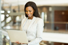 Businesswoman working on laptop. Successful black businesswoman working on laptop in office Royalty Free Stock Photo