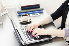 Businesswoman is working on laptop Stock Photography