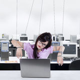 Businesswoman working like a slave royalty free stock images
