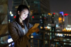 Businesswoman working on mobile phone at night Royalty Free Stock Photo