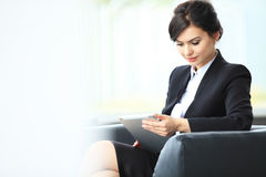 Businesswoman working new startup project modern office.Contemporary smartphone holding female hands and touching screen stock image