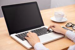 Businesswoman working with notebook laptop computer, using finger with keyboard for typing. computer laptop with black screen royalty free stock photo