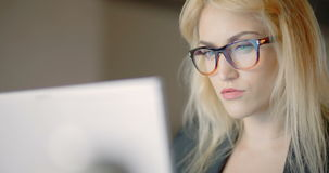 Businesswoman working on notebook in office. Tired Businesswoman working on notebook and looking at finance data in office Shoot 4K stock footage