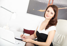 Businesswoman working at office Stock Images