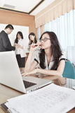 Businesswoman working in the office Stock Photo