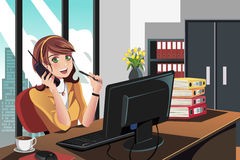 Businesswoman working in the office Stock Images