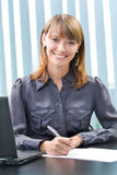 Businesswoman working at office Royalty Free Stock Photos