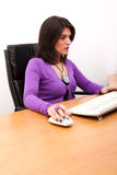 Businesswoman working at the office Stock Photos