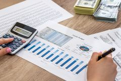 Businesswoman working in the office accounting report stock image