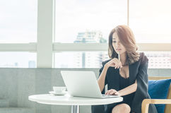 Businesswoman working at office Stock Photography