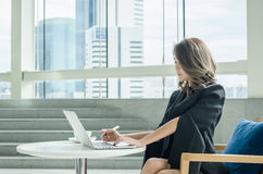 Businesswoman working at office Stock Photos