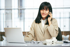 Businesswoman working in office Stock Photography