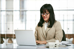 Businesswoman working in office Royalty Free Stock Image