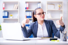 The businesswoman working in the office at desk Stock Image