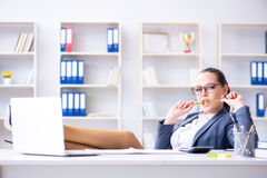 The businesswoman working in the office at desk Royalty Free Stock Image