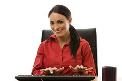 Businesswoman working at office desk Stock Photo
