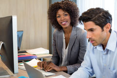 Businesswoman working in office Stock Images