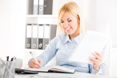 Businesswoman working in office Royalty Free Stock Photos