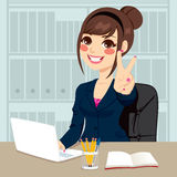Businesswoman Working At Office. Successful businesswoman making victory hand sign at his office while working typing on laptop on his desk Royalty Free Stock Photography