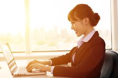 businesswoman working in the office Stock Image