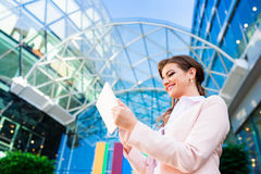 Free Businesswoman Working On Tablet Against Glassy Modern Office Building Stock Image - 66732361