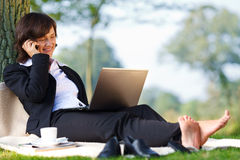Businesswoman working outdoor in park Royalty Free Stock Photos