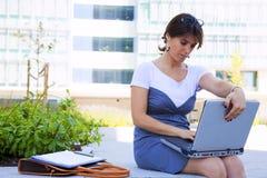 Businesswoman working outdoor Stock Image