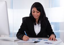 Businesswoman working on paper Royalty Free Stock Photos