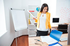 Businesswoman working with papers in office Royalty Free Stock Photos