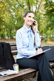 Businesswoman working in park Stock Photography
