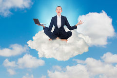 The businesswoman working in the sky and meditating Stock Images
