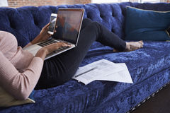 Businesswoman Working On Sofa In Modern Creative Office Royalty Free Stock Images