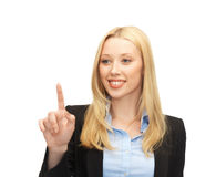 Businesswoman working with something imaginary Royalty Free Stock Photography