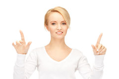 Businesswoman working with something imaginary Stock Images