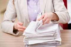 The businesswoman working with stack of papers Royalty Free Stock Images
