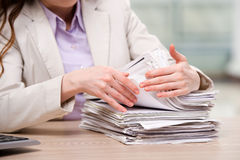 The businesswoman working with stack of papers Stock Images
