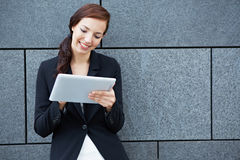 Businesswoman working on tablet Royalty Free Stock Images