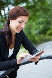 Businesswoman working with tablet Stock Photos