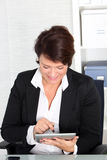 Businesswoman working on a tablet Stock Photos