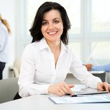 Businesswoman working with tablet. Beautiful young businesswoman working with tablet Stock Photography