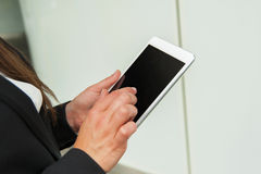 Businesswoman working on tablet closeup of technology. Stock Photography