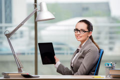 The businesswoman working on tablet computer Stock Photography