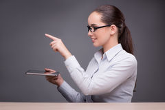 The businesswoman working on tablet computer Royalty Free Stock Photos